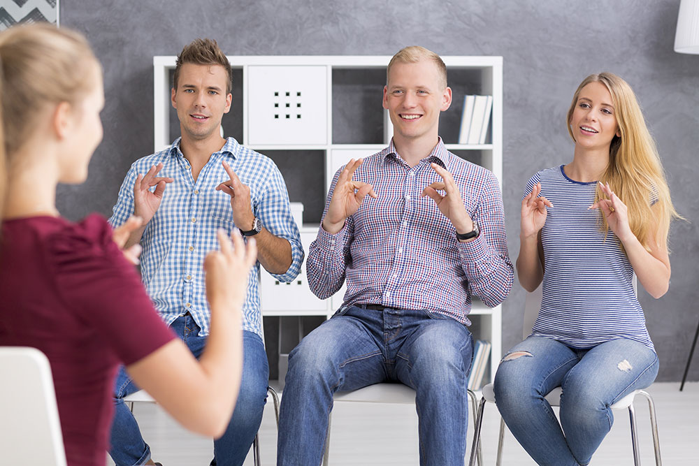 Picture of students taking ASL class
