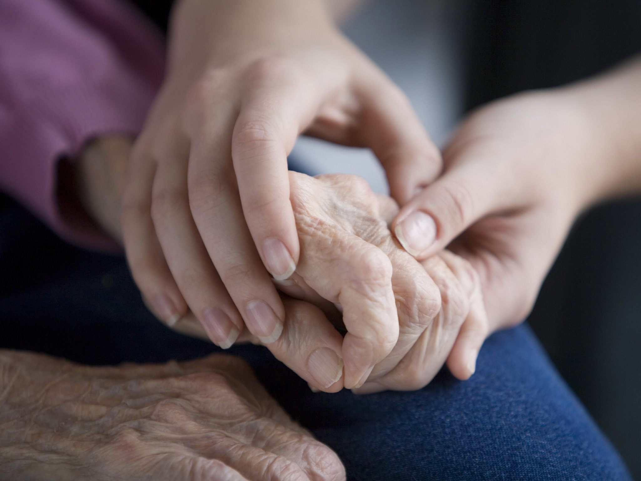 Picture of elderly holding hands